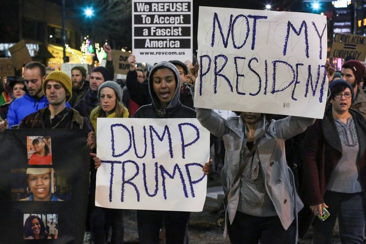 Demonstrators shout during a rally against U.S. President-elect Donald Trump in Seattle, Washington, U.S. November 20, 2016.