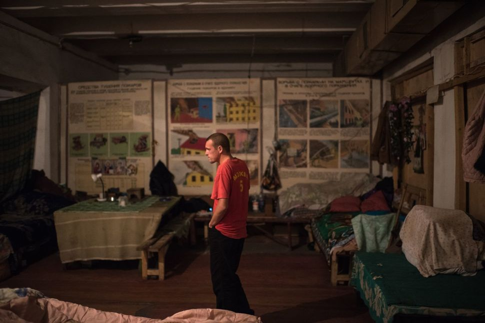 Andrei Dashkosky, 28, is one of the few younger inhabitants of the bunker. His real house is in an area deemed off-limits to