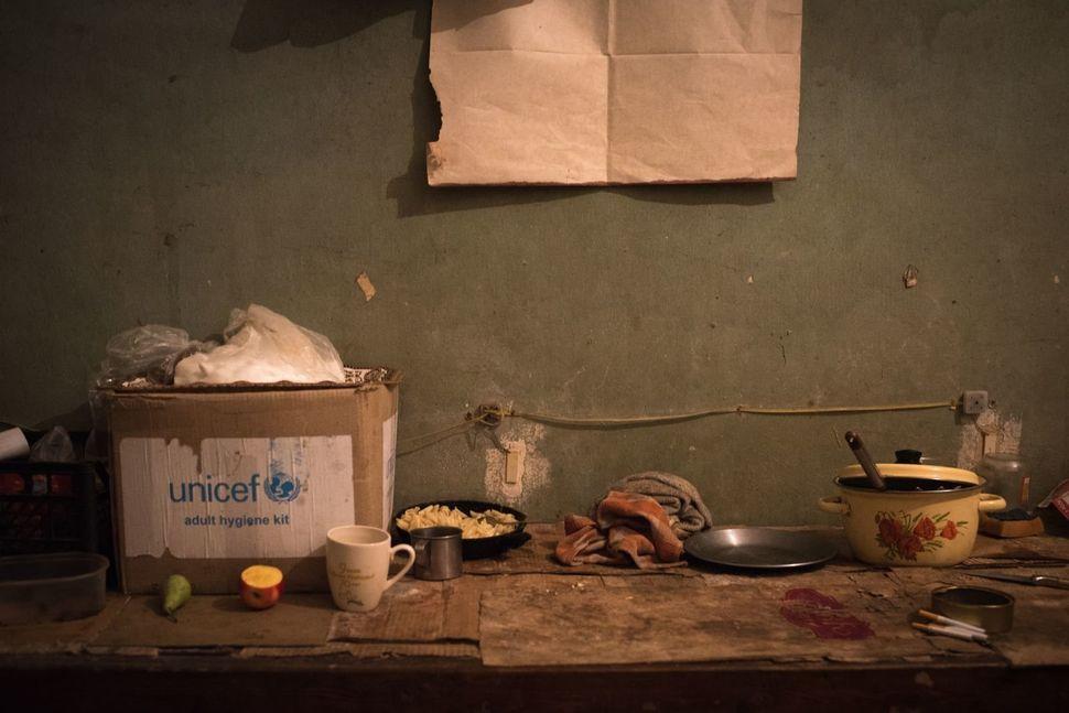 The shelf where Andrei Dashkosky and Nadia Zelenova keep their food items.
