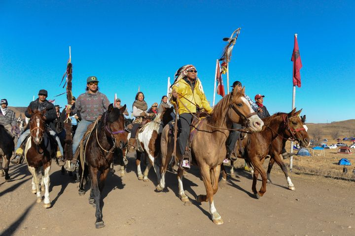 Horse riders from the Bigfoot Riders, Dakota 38 Riders, Spirit Riders and the Bigfoot Youth Riders arrive at the Oceti Sakowi