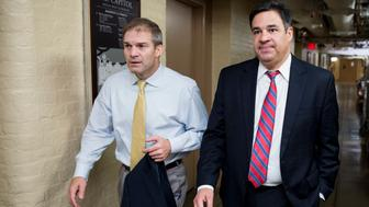 UNITED STATES - OCTOBER 26: From left, Rep. Jim Jordan, R-Ohio, and Rep. Raul Labrador, R-Idaho, arrive for the House Republican Conference meeting in the basement of the Capitol on Monday, Oct. 26, 2015. (Photo By Bill Clark/CQ Roll Call)