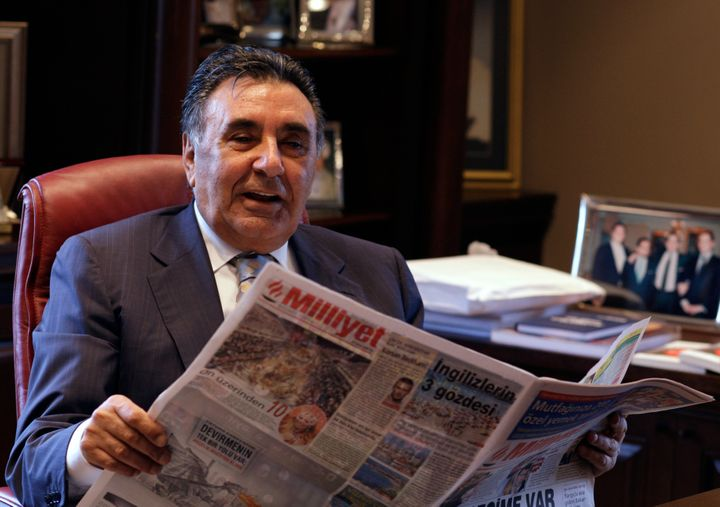 Aydin Dogan holds a copy of his daily newspaper Milliyet at his Istanbul office in 2009. His Dogan Media Group properties hav