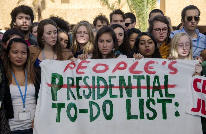 American students protest outside the UN climate talks during the COP22 international climate conference in Marrakesh, Morocc