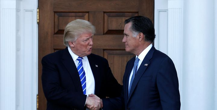 U.S. President-elect Donald Trump (L) shakes hands with former Massachusetts Governor Mitt Romney after their meeting at the