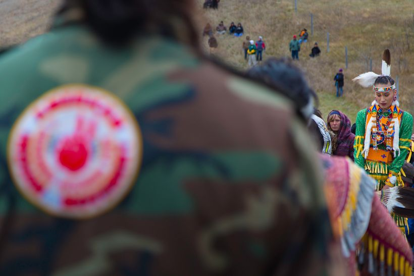 A TIME TO REFLECT. A Jingle dancer and water protectors at the sacred ceremonial Jingle dance on October 29 at the Treaty/Sac