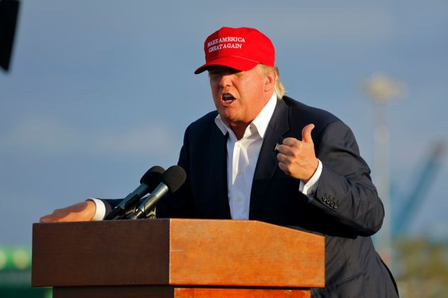 Donald Trump gives the thumbs up while wearing his campaign hat promising to 'Make America Great
