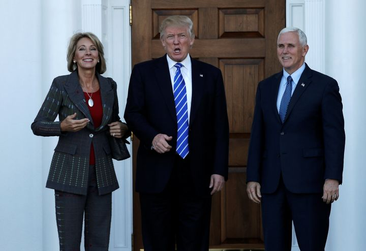 Education Secretary nominee Betsy DeVos with President-elect Donald Trump and Vice President-elect Mike Pence at Trump N