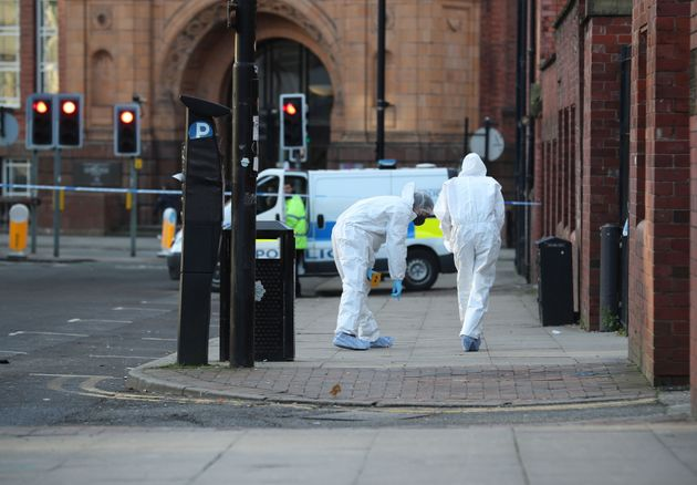 Forensic police outside Manchester College, where two teenagers were stabbed on