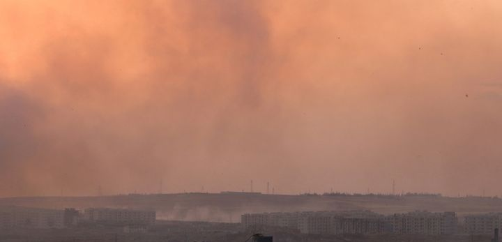 An American soldier has reportedly died following an IED blast in northern Syria. Pictured here, smoke rises over Syria on Ju