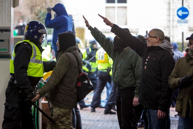 Fascist demonstrators show the Nazi salute in Dover during clashes with anti-Fascist