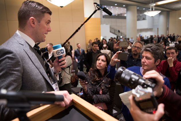 Richard Spencer (left) talks to the media at the National Policy Institute