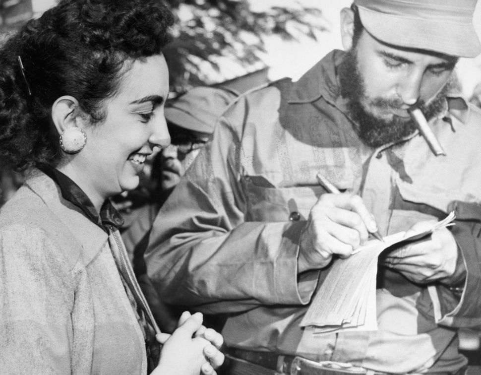 Castro gives an autograph to an admirer in Camaguey, Cuba on Jan. 7, 1959. While Cubans awaited Castro's arrival in Havana, c