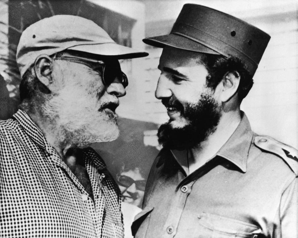 American author Ernest Hemingway speaks with Castro in Cuba in late 1959. In 1960 Hemingway was forced out of his home in Cub