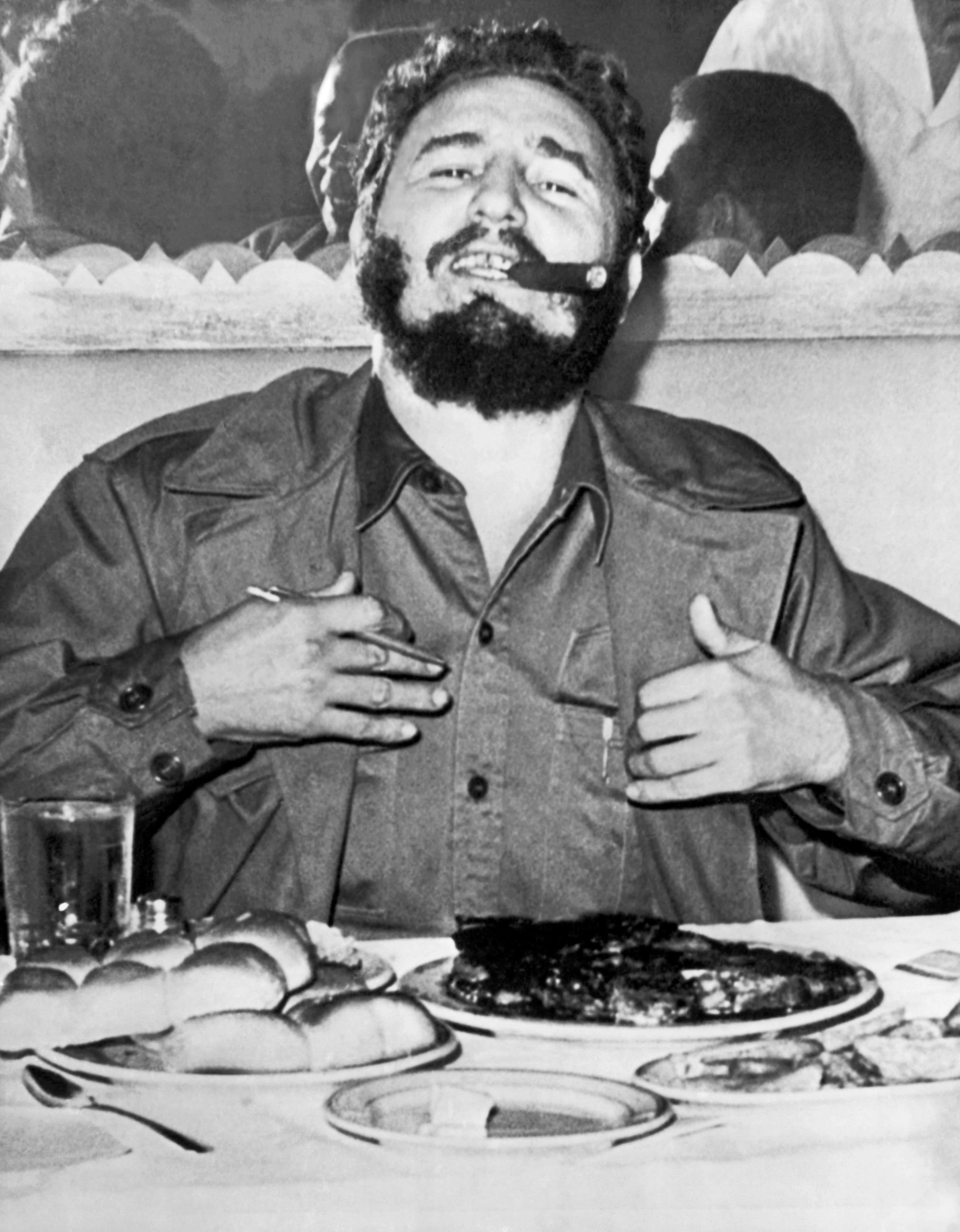 Castro enjoys a steak dinner while holding an impromptu press conference at the Theresa Hotel in Harlem during his visit to N