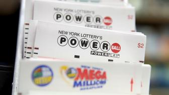Powerball lottery tickets sit on the counter in a store in the Manhattan borough of New York January 5, 2016. Powerball's jackpot has surged to an estimated $450 million after the first drawing of the new year resulted in no winning ticket holders, the operator of the multistate game said on Sunday. Powerball, played in 44 states, two U.S. territories and Washington, D.C., will hold its next drawing on Wednesday, giving players another crack at the grand prize.  REUTERS/Andrew Kelly