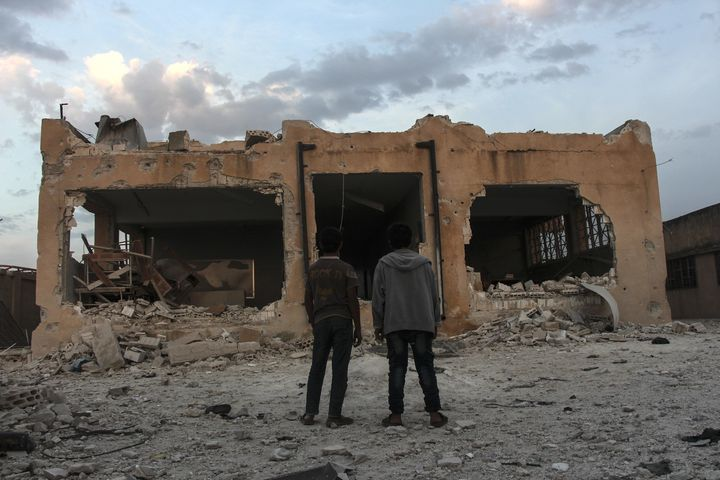 Syrians inspect the school in Haas that was destroyed by an Oct. 26 airstrike.