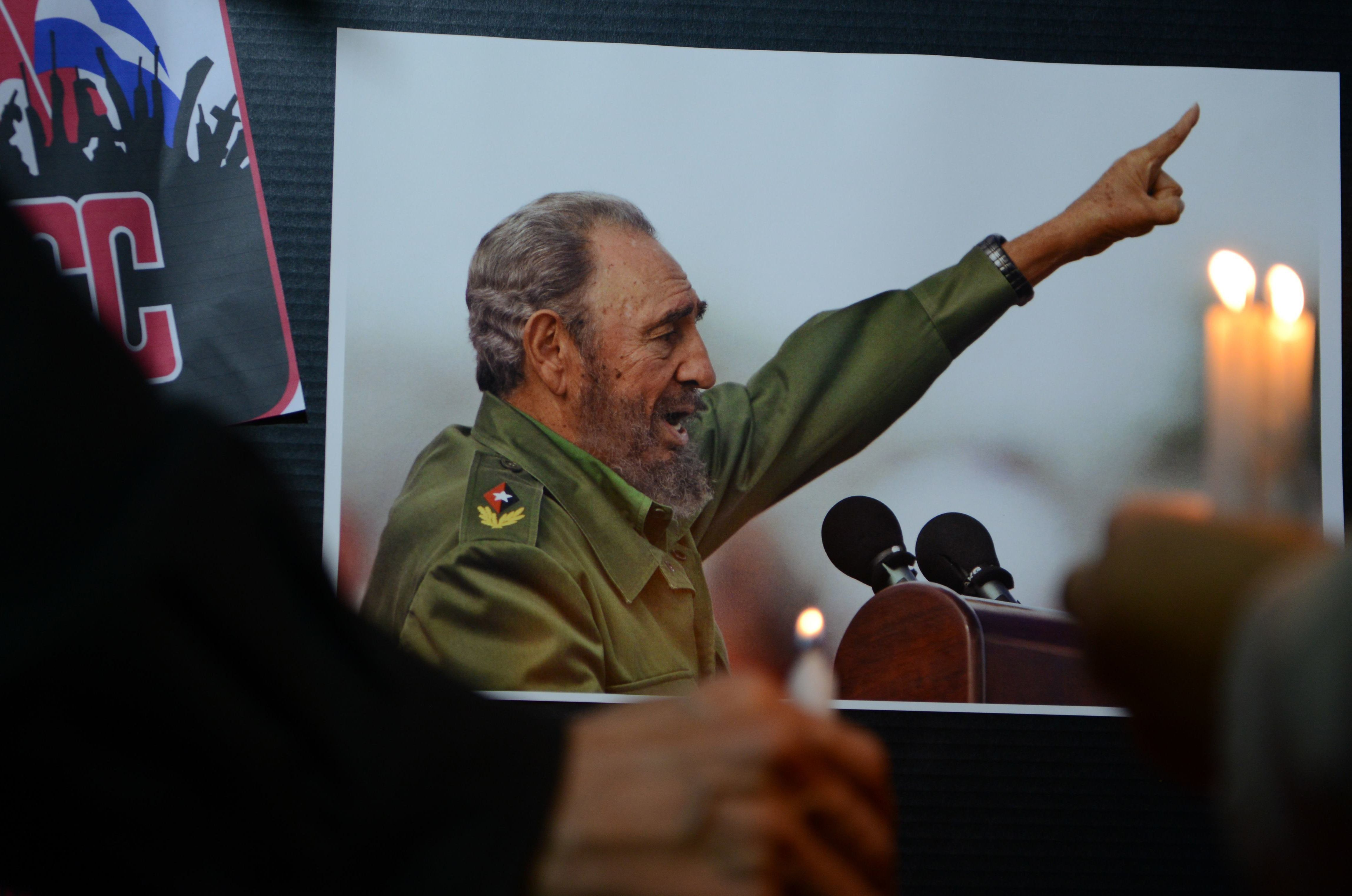 Honduras' former president Manuel Zelaya (L) holds a candle to pay tribute to Cuban historic revolutionary leader Fidel Castro a day after his death, during a gathering at Marti Square in Tegucigalpa, on November 26, 2016. Cuban revolutionary icon Fidel Castro died late Friday in Havana, his brother, President Raul Castro, announced on national television. Castro's ashes will be buried in the historic southeastern city of Santiago on December 4 after a four-day procession through the country. / AFP / Orlando SIERRA        (Photo credit should read ORLANDO SIERRA/AFP/Getty Images)