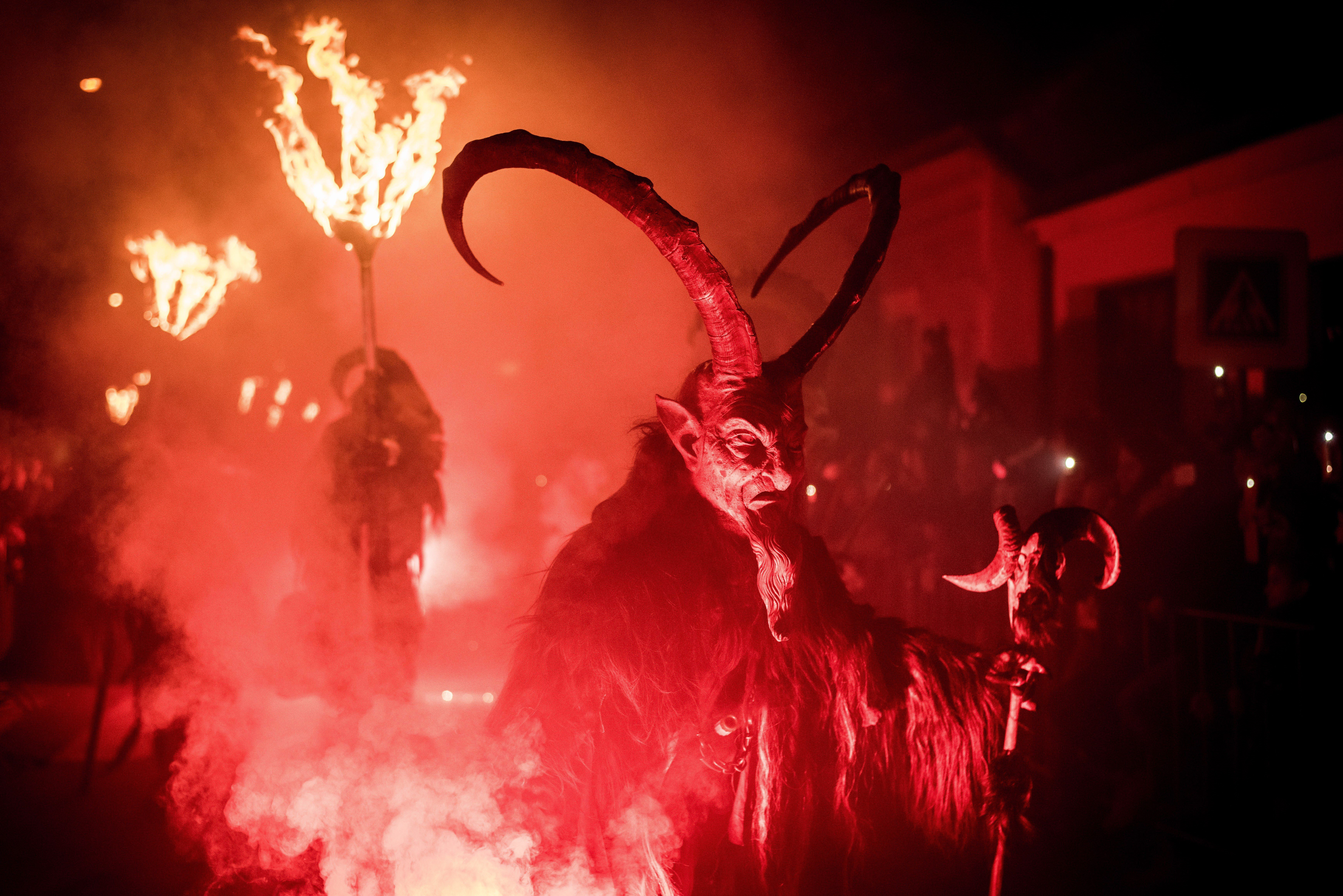 ZIDLOCHOVICE, CZECH REPUBLIC - NOVEMBER 26: Participants dressed as Krampus walk at the street during Krampus gathering on November 26, 2016 in Zidlochovice (at Brno), Czech Republic.  (Photo by Lukas Kabon/Anadolu Agency/Getty Images)