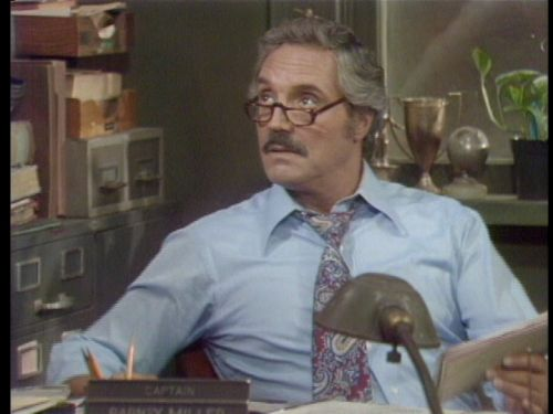 Hal Linden as the kindhearted Captain of the 12th Precinct, Barney Miller.