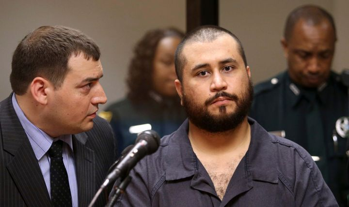 George Zimmerman, right, the acquitted shooter in the death of Trayvon Martin, listens to defense counsel Daniel Megaro durin