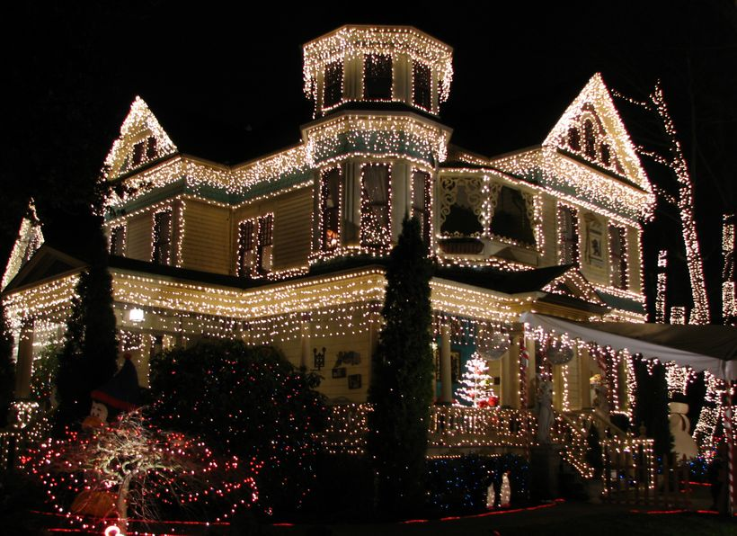 Victorian home adorned to celebrate the holiday season.