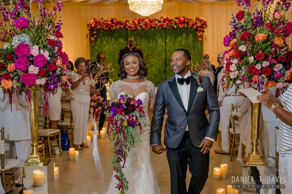 """Brittnee and Quincy were married on Black Friday in a romantic Houston, Texas venue with a lush vine backdrop with hints of"