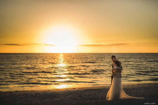 """Melanie and Scott share their first sunset together as husband and wife at The Postcard Inn in St. Petersburg, Florida."" --&"
