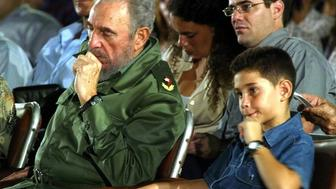 CUBA - OCTOBER 20:  File Photo of Fidel Castro and Elian Gonzalez in Santa Clara, Cuba on October 20th, 2004 - Cuban President Fidel Castro is seen in Santa Clara, about 300 km (183 miles) East of Havana, Cuba with Cuban boy Elian Gonzalez - US Channel CBS published last October 3rd, 2005 an exclusive interview of Elian Gonzales who declared he wants to be member of the Cuban National Assembly and he considers Fidel Castro as a friend and a father - Photo by Jose Goitia/GAMMA.  (Photo by Jose GOITIA/Gamma-Rapho via Getty Images)
