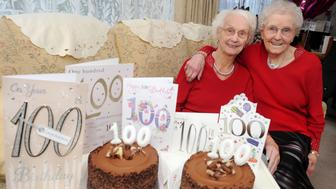 PIC BY KORAY EROL/CATERS NEWS (Pictured: Irene Crump and Phyllis Jones posing with their birthday cards and cakes for their 100th birthday) - These twins have proved theyre quite the sister act after celebrating their 100th birthday. Irene Crump and Phyllis Jones have spent a whole century together after being born 25 minutes apart on November 20 1916 - and even live together in Stourport, Worcs. The twins - who arent identical but look remarkably similar - attended the same school and shared their first job at Steatite Porcelain Products before Irene married farmer Samuel Crump. The duo put their milestone birthday down to hard work and good food. SEE CATERS COPY