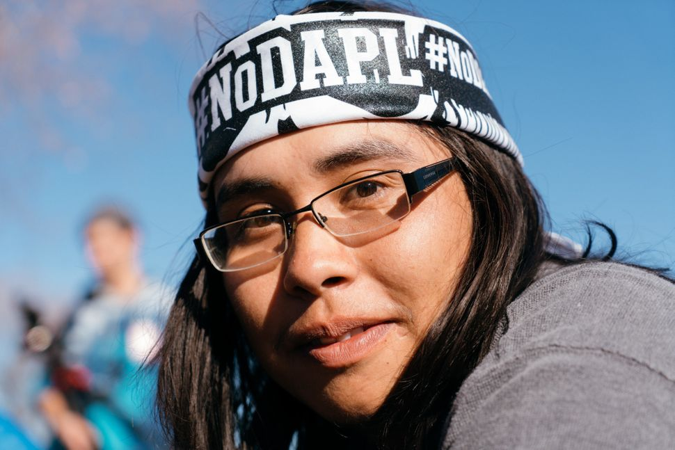 A protesterfrom New Mexico poseswhile at Standing Rock.