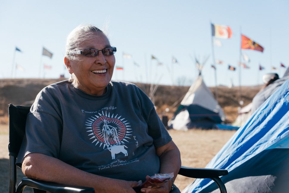 A camp elder travels with her daughter, retelling the history of the Lakota people.