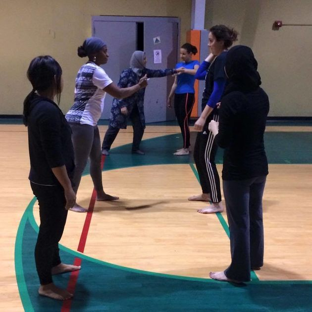 Women participate in a self-defense class at Deaf Planet
