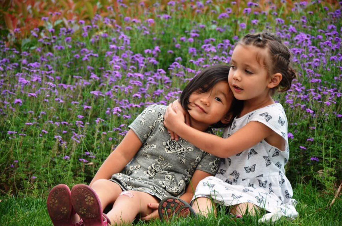"""""""Just seven months apart in age, these girls are 'real' sisters... They really adore one another, really fight(!) and -- they"""