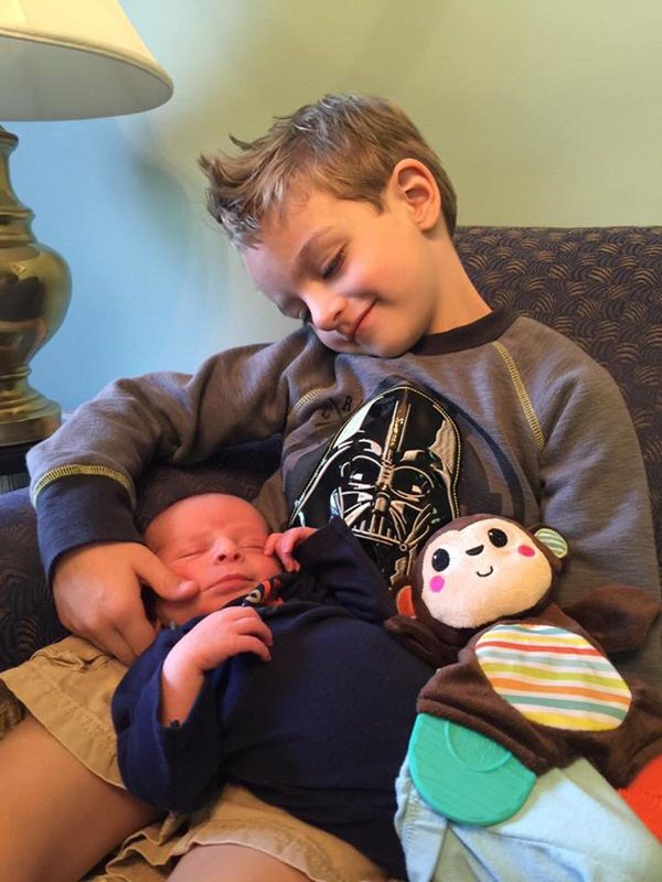 """""""This is Philip and his new little brother, Levi. Photo was taken on the day we first met Levi, and Philip hasn't wanted to b"""