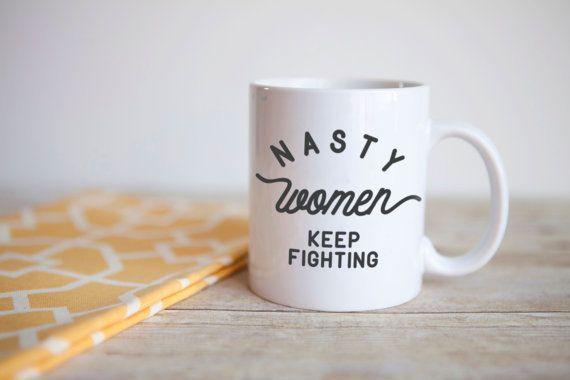 "$13.97, Driinky. <a href=""https://www.etsy.com/listing/477597632/nasty-women-keep-fighting-mug-feminist?ga_order=most_relevan"