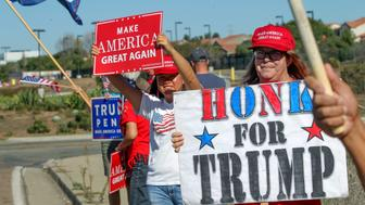 Mari Hayden joins supporters of US President-elect Donald Trump holding a street-side rally in front of Marine Corps Base Camp Pendleton in Oceanside, California, on November 11, 2016. / AFP / Bill Wechter        (Photo credit should read BILL WECHTER/AFP/Getty Images)