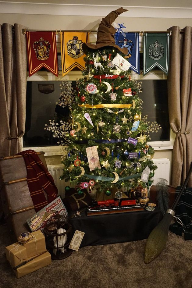 Presents, a scarf, a tiny Hogwarts Express replica and an owl complete the tree's