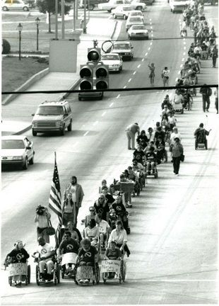 <strong>Photo: ADAPT disability rights activists marching in the streets in protest in 1990. </strong>