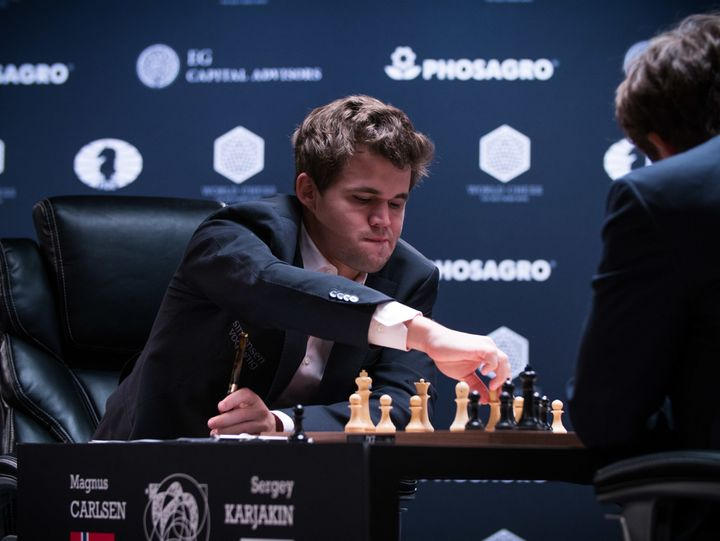 Magnus Carlsen makes a move in game 12 of the World Chess Championship