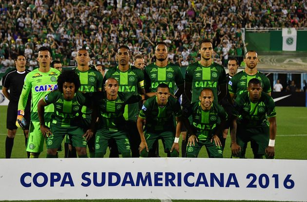 Chapecoense players pose for pictures during their 2016 Copa Sudamericana semifinal against Argentinas...