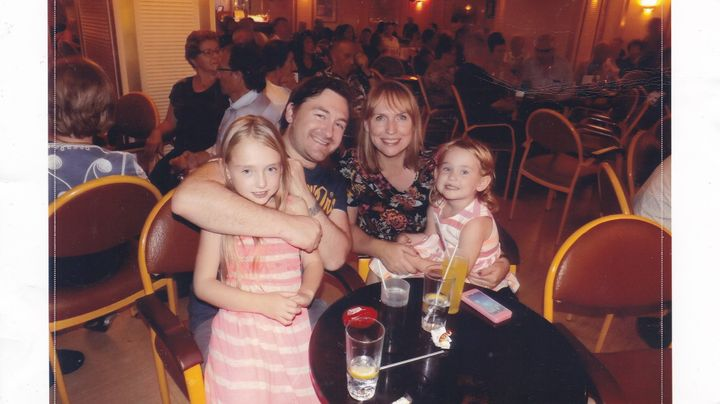 George Maxwell with his wifeSarah and their two daughters Summer, nine, and Cadence, six.