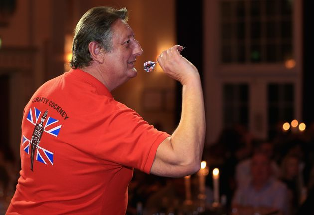 Former darts champion dropped from TV over abuse comments