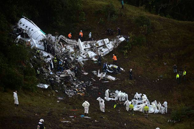 Rescuers search for survivors from the wreckage of the LAMIA airlines charter