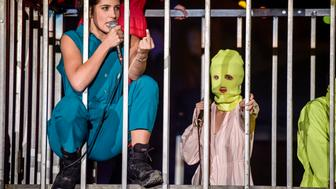 Pussy Riot perform in a metal cage atBanksy's 'Dismaland' in Weston-super-Mare, Somerset.