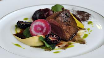 A roasted cocoa ash rolled loin of venison dish, on offer to dinners during the Chocolate Show at Olympia's National Hall, London.