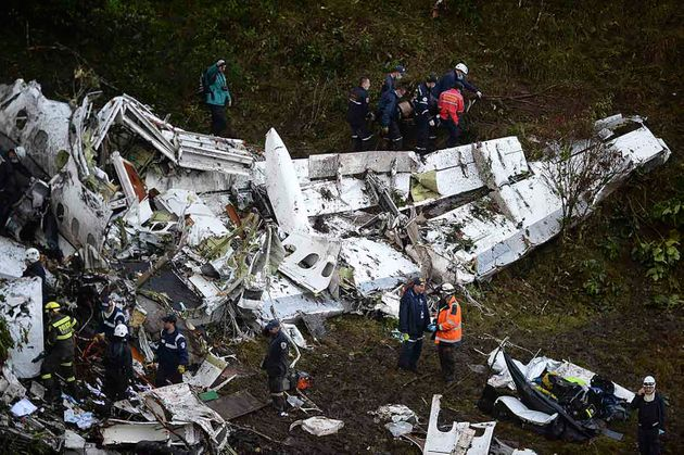 Rescuers search for survivors from the wreckage of the LAMIA airlines charter plane carrying members...