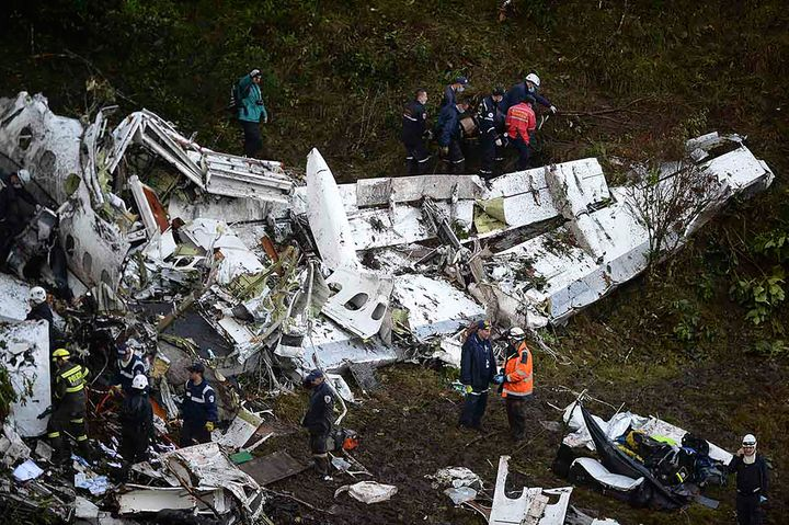 Rescuers search for survivors from the wreckage of the LAMIA airlines charter plane carrying members of the Chapecoense Real