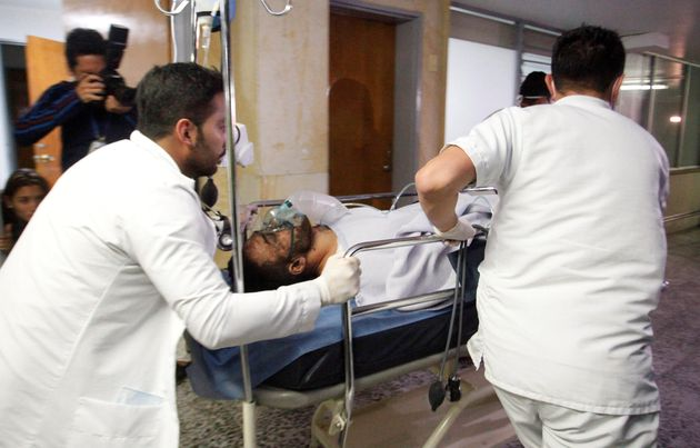 Brazilian soccer player Alan Luciano Ruschel of Chapecoense soccer club receives medical attention after...
