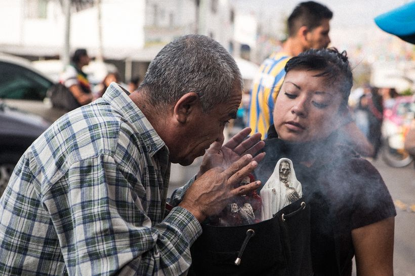Blessing Santa Muerte with holy smoke at the Tepito shrine