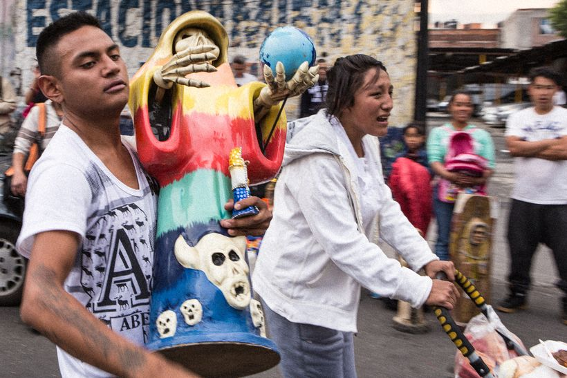 A devotee who brought his Santa Muerte of the 7 Powers statue to be blessed at the Tepito shrine